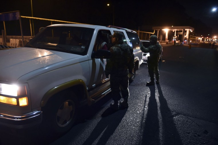 "Mexican soldiers take part in a search operation to locate Mexican drug trafficker Joaquin Guzman Loera aka ""el Chapo Guzman along the highway between Mexico City and Toluca on July 12, 2015. Mexican drug lord Joaquin ""El Chapo"" Guzman has escaped from a maximum-security prison for the second time in 14 years, sparking a massive manhunt and dealing an embarrassing blow to the government. The kingpin was last spotted by security cameras entering the shower area of the Altiplano prison, 90 kilometers (55 miles) west of Mexico City, on July 11 night before disappearing, the National Security Commission said. (Yuri Cortez/AFP/Getty Images)"