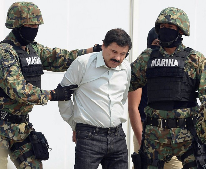 "Mexican drug trafficker Joaquin Guzman Loera aka ""el Chapo Guzman"" (C), is escorted by marines as he is presented to the press on February 22, 2014 in Mexico City. Mexican drug lord Joaquin ""El Chapo"" Guzman has escaped from a maximum-security prison for the second time in 14 years, sparking a massive manhunt Sunday and dealing an embarrassing blow to the government. (Alfredo Estrella/AFP/Getty Images)"