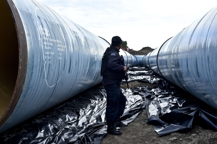 "Federal policemen inspect a pipeline under construction by the Altiplano prison in Almoloya de Juarez, Mexico on July 12, 2015. Mexican drug lord Joaquin ""El Chapo"" Guzman has escaped from a maximum-security prison, the government said Sunday, his second jail break in 14 years. The kingpin was last seen in the shower area of the Altiplano prison in central Mexico late Saturday before disappearing. ""The escape of Guzman was confirmed"", the National Security Commission said in a statement. (Yuri Cortez/AFP/Getty Images)"