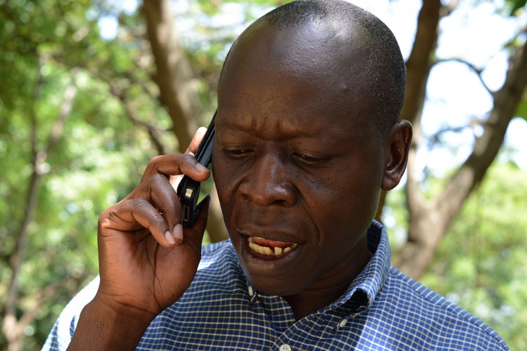 "Kenyan Said Obama, Kogelo-born, raised and current resident and uncle to United State's President Barack Obama, speaks on the phone during an interview in Kisumu on July 13, 2015. The Kenyan Obamas are related to the US president through his Kenyan-born father, Barack Hussein Obama Senior, who died in 1982. Excitement is growing in Kenya ahead of Barack Obama's first visit to his father's homeland since becoming president. Anticipation ahead of the late July trip is nowhere greater than in Kogelo, ""a sleepy village"" that Said says was ""put on the world map"" by its association with the US president. (Simon Maina/AFP/Getty Images)"