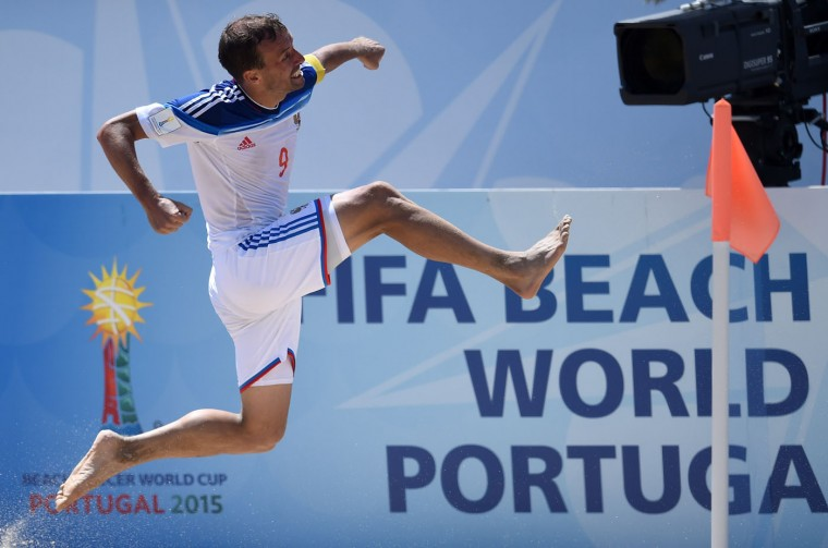 Russia's pivot Egor Shaikov celebrates after scoring a goal on overtime during the FIFA Beach Soccer World Cup football match Brazil vs Russia in Espinho on July 16, 2015. Russia won and is qualified for semi-finals. (Francisco Leong/AFP/Getty Images)
