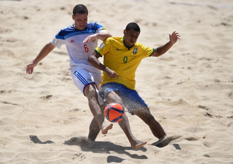 Russia's wing Dmitrii Shishin (L) vies with Brazil's pivot Rodrigo during the FIFA Beach Soccer World Cup football match Brazil vs Russia in Espinho on July 16, 2015. Russia won and is qualified for semi-finals. (Francisco Leong/AFP/Getty Images)