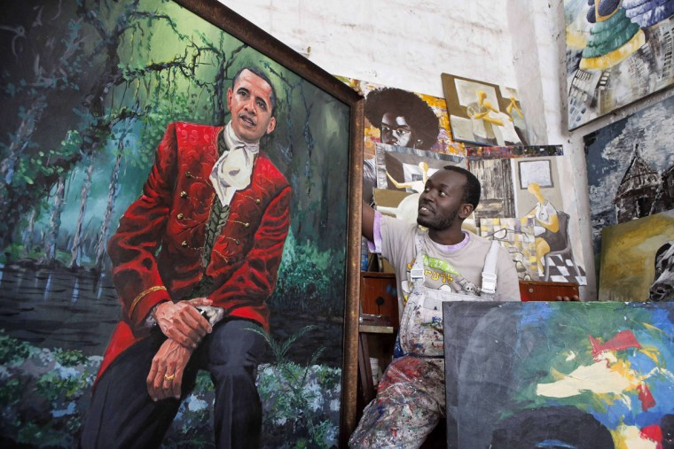 Kenyan artist Yegonizer poses next to one of his paintings depicting US President Barack Obama on July 15, 2015 at the Go Down Art Centre in Nairobi. Excitement is growing in Kenya ahead of US President Barack Obama's first in late July visit to his father's homeland since becoming president. (Till Muellenmeister/AFP/Getty Images)