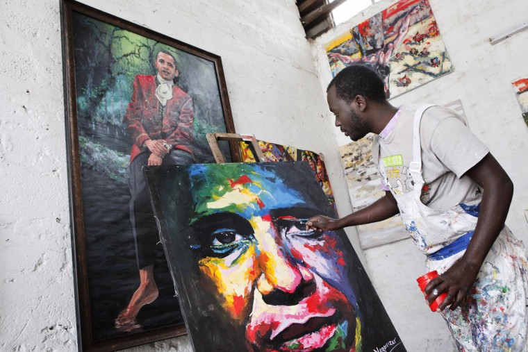 Kenyan artist Yegonizer (R) works on a painting depicting US President Barack Obama on July 15, 2015 at the Go Down Art Centre in Nairobi. Excitement is growing in Kenya ahead of US President Barack Obama's first in late July visit to his father's homeland since becoming president. (Till Muellenmeister/AFP/Getty Images)