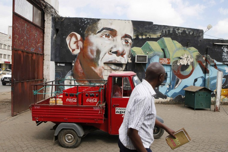 A man walks as a delivery truck passes a graffito by artists Bankslave and Swift depicting US President Barack Obama on July 15, 2015 at the Go Down Art Centre in Nairobi. Excitement is growing in Kenya ahead of US President Barack Obama's first in late July visit to his father's homeland since becoming president. (Till Muellenmeister/AFP/Getty Images )