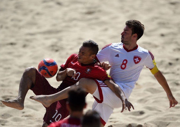 Portugal's wing Belchior (L) vies with Switzerland's defender Mo Jaeggy during the FIFA Beach Soccer World Cup football match Portugal vs Switzerland in Espinho on July 16, 2015. (Francisco Leong/AFP/Getty Images)