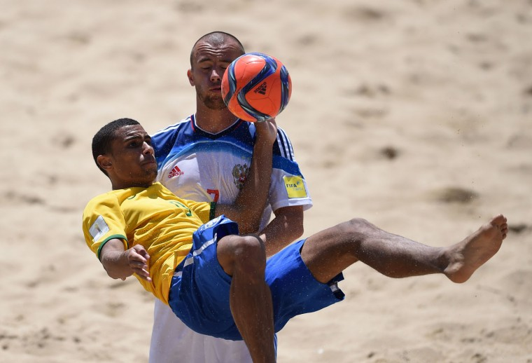 Brazil's pivot Rodrigo (L) vies with Russia's defender Anton Shkarin during the FIFA Beach Soccer World Cup 2015 football match Brazil vs Russia in Espinho on July 16, 2015. (Francisco Leong/AFP/Getty Images)