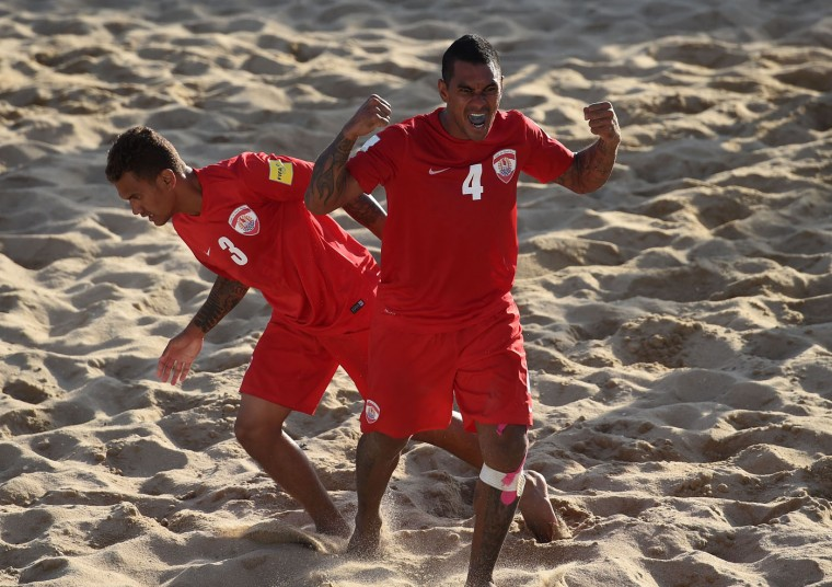 Tahiti's defender Heimanu Taiarui (R) celebrates after scoring a goal during the FIFA Beach Soccer World Cup 2015 football match Iran vs Tahiti in Espinho on July 16, 2015. (Francisco Leong/AFP/Getty Images)