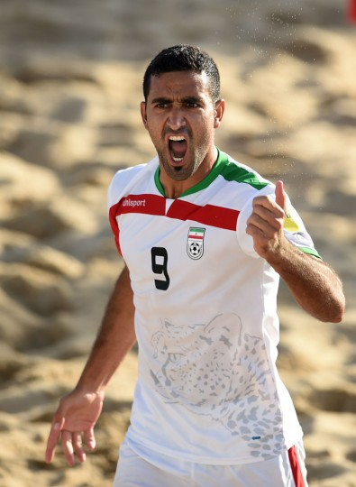Iran's wing Mohammad Mokhari celebrates after scoring a goal during the FIFA Beach Soccer World Cup 2015 football match Iran vs Tahiti in Espinho on July 16, 2015. (Francisco Leong/AFP/Getty Images)