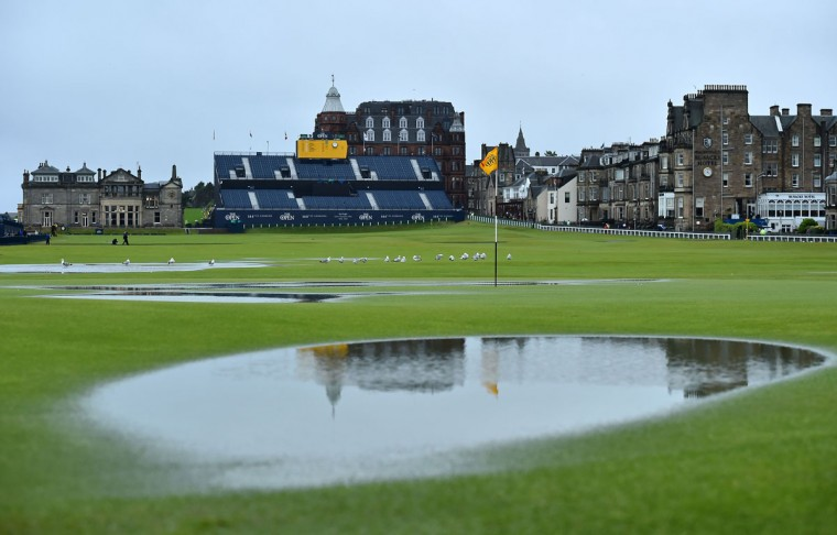 Standing water is seen on the 1st green after heavy rain make the course unplayable early on the second day of the 2015 British Open Golf Championship on The Old Course at St Andrews in Scotland, on July 17, 2015. By 8:00 p.m. large puddles had formed on the Old Course's fairways and greens as the deluge continued and director of greenkeeping Gordon Moir said that no time could yet be set for play to resume. (AFP Photo/Ben Stansall)