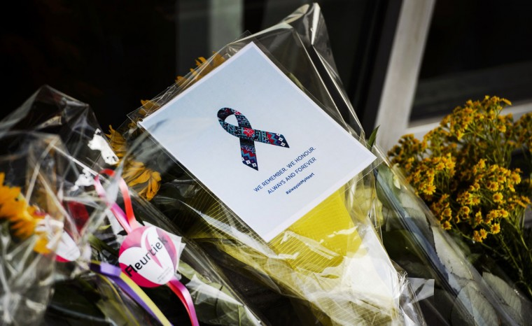 Flowers were laid in front of the departure hall 3, at the airport in Schiphol, the Netherlands, on July 17, 2015, in memory of the people who died in the crash of Malaysian Airlines flight MH17 a year ago. All 298 passengers and crew -- the majority Dutch -- died on July 17 last year when the Malaysia Airlines Boeing 777, on a flight between Amsterdam and Kuala Lumpur, was shot down over rebel-held east Ukraine during heavy fighting between Ukrainian forces and pro-Russian separatists. (AFP Photo/Anp / )