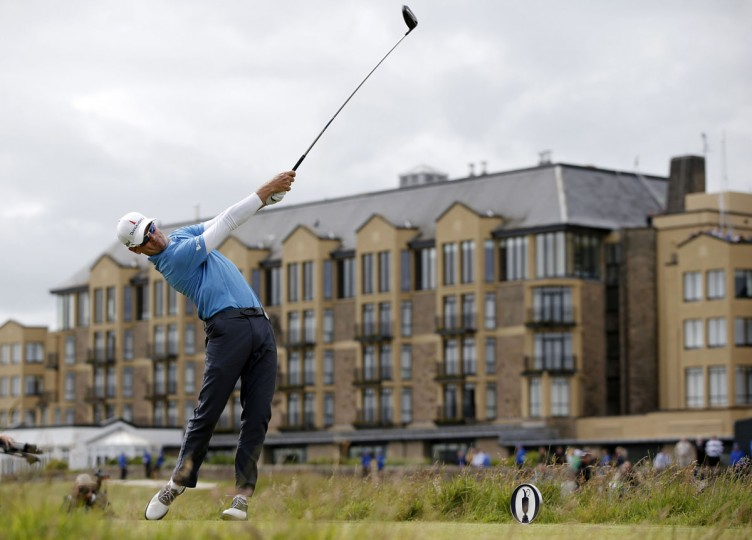 US golfer Zach Johnson plays from the 3rd tee during his second round on day two of the 2015 British Open Golf Championship on The Old Course at St Andrews in Scotland, on July 17, 2015. Torrential early rain left its mark on the Old Course at St Andrews as play was suspended for more than three hours and continued to have an effect when play restarted. The delay may mean that the later starters will be unable to complete their second round by day's end. (AFP Photo/Adrian Dennis)