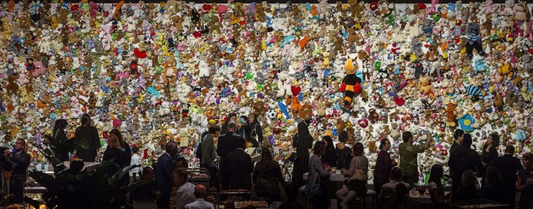 Family members and friends of victims gather in front of a 'hedge of compassion' , made of thousands of dolls , during a commemoration ceremony for the people who died in the crash of Malaysian Airlines flight MH17, in Nieuwegein, near the central city of Utrecht, the Netherlands, on July 17, 2015. All 298 passengers and crew -- the majority Dutch -- died on July 17 last year when the Malaysia Airlines Boeing 777, on a flight between Amsterdam and Kuala Lumpur, was shot down over rebel-held east Ukraine during heavy fighting between Ukrainian forces and pro-Russian separatists. (AFP Photo/Pool / )