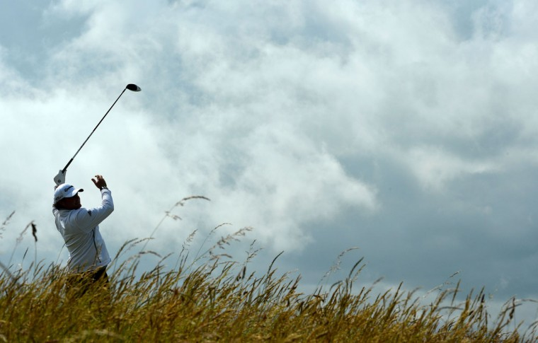 Australia's Steven Bowditch releases his club as he watches his shot from the 6th tee during his second round on day two of the 2015 British Open Golf Championship on The Old Course at St Andrews in Scotland, on July 17, 2015. Torrential early rain left its mark on the Old Course at St Andrews as play was suspended for more than three hours and continued to have an effect when play restarted. The delay may mean that the later starters will be unable to complete their second round by day's end. (AFP Photo/Glyn Kirk)