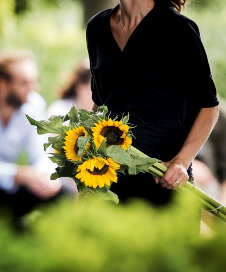 A woman holding flowers arrives at the commemoration ceremony for the people who died in the crash of the Malaysian Airlines flight MH17, in Nieuwegein, near the central city of Utrecht, Netherlands, on July 17, 2015. All 298 passengers and crew - the majority Dutch - died on July 17 last year when the Malaysian Airlines Boeing 777, on a flight between Amsterdam and Kuala Lumpur, was shot down over rebel-held east Ukraine during heaving fighting between Ukrainian forces and pro-Russian separatists. (AFP Photo/Anp / )