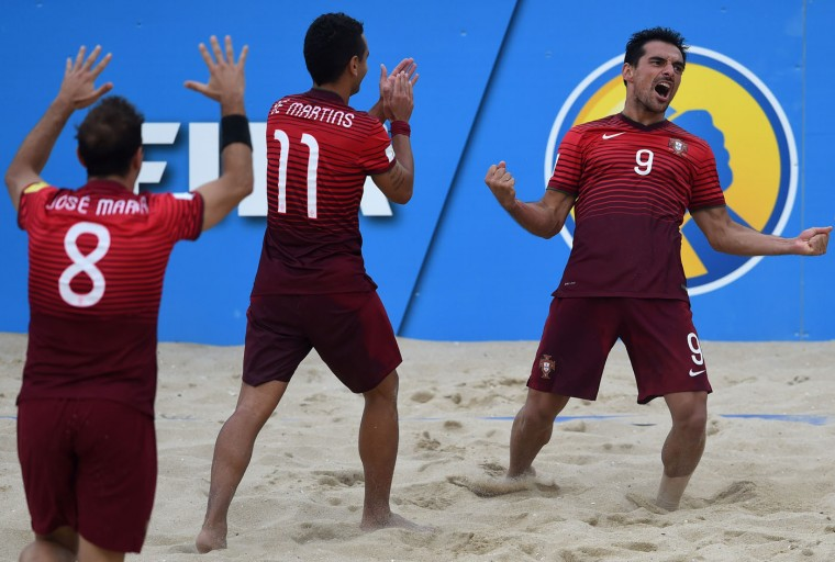 Portugal's defender Bruno Novo (R) celebrates after scoring a goal during the FIFA Beach Soccer World Cup football match Portugal vs Russia in Espinho on July 18, 2015. (Francisco Leong/AFP/Getty Images)
