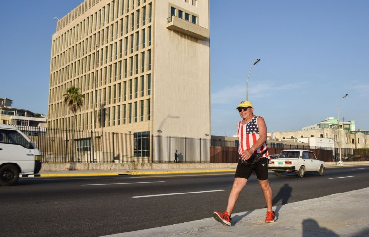 A man wearing a sleeveless shirt with the US flag walks along the Malecon seafront near the US Embassy, on July 20, 2015. The United States and Cuba formally resumed diplomatic relations Monday, as the Cuban flag was raised at the US State Department in a historic gesture toward ending decades of hostility between the Cold war foes. (AFP Photo/P /adalberto )