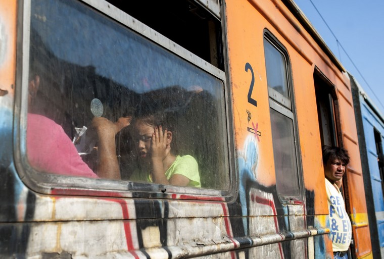 Migrants try to board a train to Serbia in the town of Gevgelija, on the Macedonian-Greek border, on July 21, 2015. (ROBERT ATANASOVSKI/AFP/Getty Images)