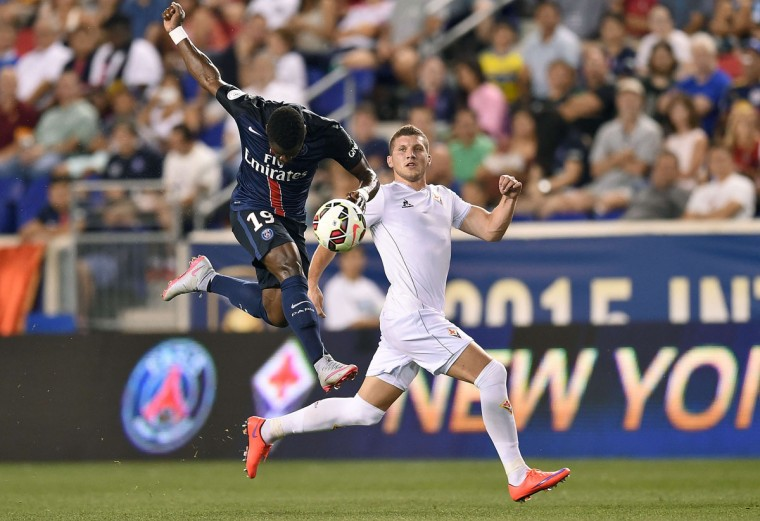 PSG's Defender Serge Aurier (left) heads the ball as he vies with Fiorentina's forward Ante Rebic during their International Champions Cup match at the Red Bull Arena in Harrison, New Jersey, on July 21, 2015. (JEWEL SAMAD/AFP/Getty Images)