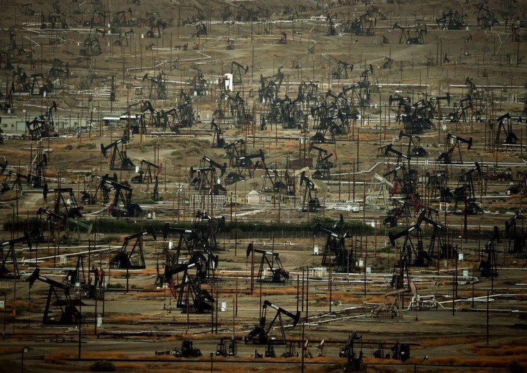 A general view shows oil pumping jacks and drilling pads at the Kern River Oil Field where the principle operator is the Chevron Corporation in Bakersfield, California on July 28, 2015. (MARK RALSTON/AFP/Getty Images)