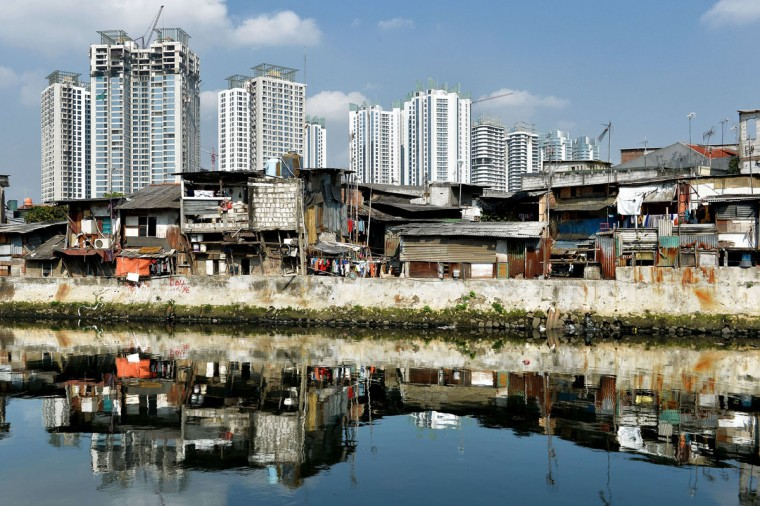 This photo taken on July 29, 2015 shows under construction apartment buildings and shanty houses in downtown Jakarta. (BAY ISMOYO/AFP/Getty Images)