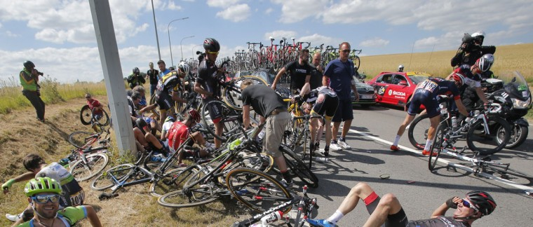 Scores of riders lie on the road after crashing during the third stage of the Tour de France cycling race over 159.5 kilometers (99.1 miles) with start in Antwerp and finish in Huy, Belgium, Monday, July 6, 2015. (AP Photo/Christophe Ena)