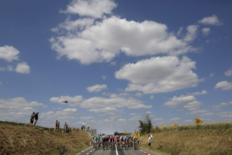 The pack rides during the third stage of the Tour de France cycling race over 159.5 kilometers (99.1 miles) with start in Antwerp and finish in Huy, Belgium, Monday, July 6, 2015. (AP Photo/Laurent Cipriani)