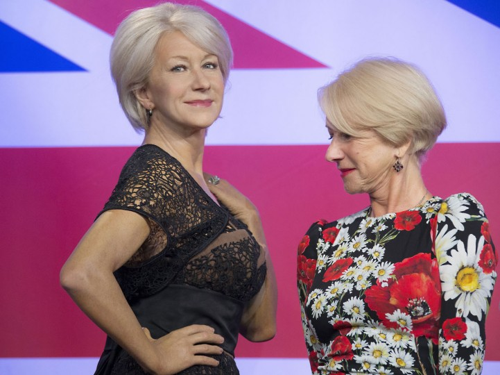 British actress Helen Mirren looks at one of three wax figures of herself, made in celebration of her recent 70th birthday, at Madame Tussauds in central London, Thursday, July 30, 2015. (Joel Ryan/Invision/AP)