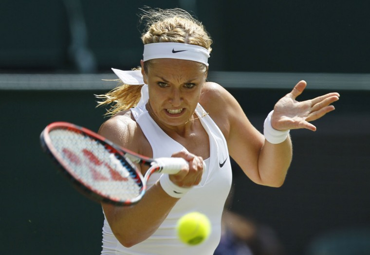 Sabine Lisicki of Germany makes a return to Christina McHale of the United States during their singles match at the All England Lawn Tennis Championships in Wimbledon, London, Thursday July 2, 2015. (AP Photo/Pavel Golovkin)