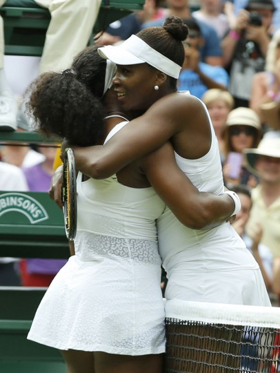 Serena Williams of the United States, left, hugs her sister Venus Williams of the United States after winning their singles match, at the All England Lawn Tennis Championships in Wimbledon, London, Monday July 6, 2015. Serena Williams won 6-4, 6-3. (AP Photo/Alastair Grant)
