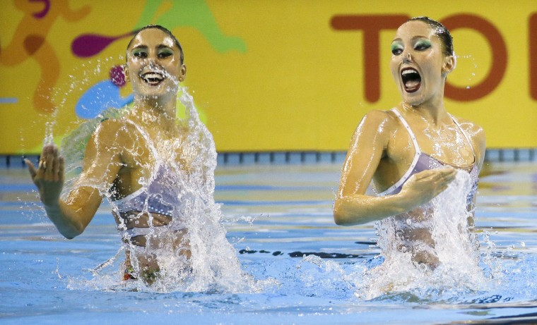 Luisa Borges and Maria Eduarda De Souza of Brazil perform during the synchronized swimming duet technical routine competition at the Pan Am Games Thursday, July 9, 2015, in Toronto. (AP Photo/Mark Humphrey)