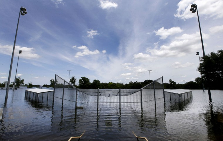 A baseball field and bleachers sit submerged at Oak Grove Park on the shores of Grapevine Lake, Wednesday, July 1, 2015, in Grapevine, Texas. As the holiday weekend approaches, many lakeside parks in Texas are closed due to the high lake levels caused by record rain amounts. (AP Photo/LM Otero)
