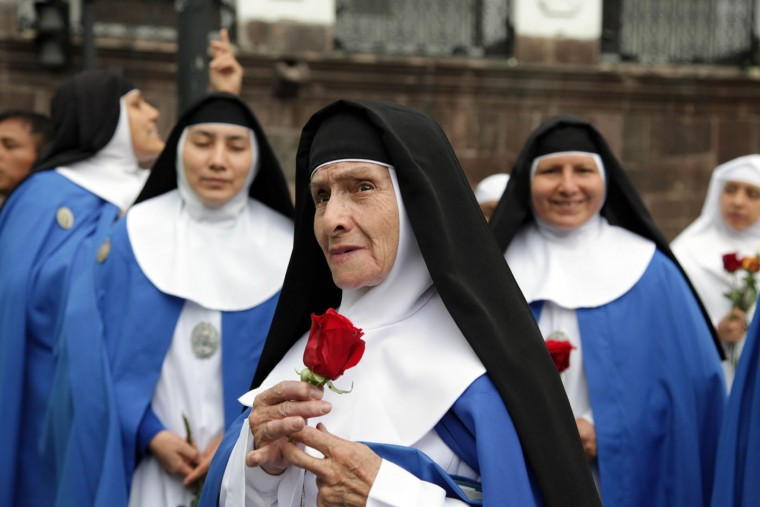 Nuns arrive at Independence square, invited to attend the meeting of Pope Francis and Ecuador's President Rafael Correa in Quito, Ecuador, Monday, July 6, 2015. After a Mass in the port city of Guayaquil where hundreds of thousands listened to Pope Francis while standing in the hot sun, he will return to the Capital of Quito. Francis is making his first visit as pope to his Spanish-speaking neighborhood. He'll travel to three South American nations, Ecuador, Bolivia and Paraguay. (AP Photo/Ana Buitron)