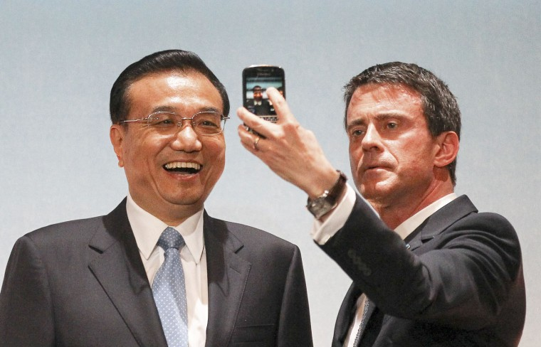 "Prime Minister Manuel Valls, right, and Chinese Premier Li Keqiang, make a selfie at the end the Franco-Chinese Economic Summit ""Innovating for the future, build together "" in Toulouse, southwestern France, Thursday July 2, 2015. Li Keqiang will later visit the European plane maker Airbus plant. (AP Photo/Fred Scheiber)"