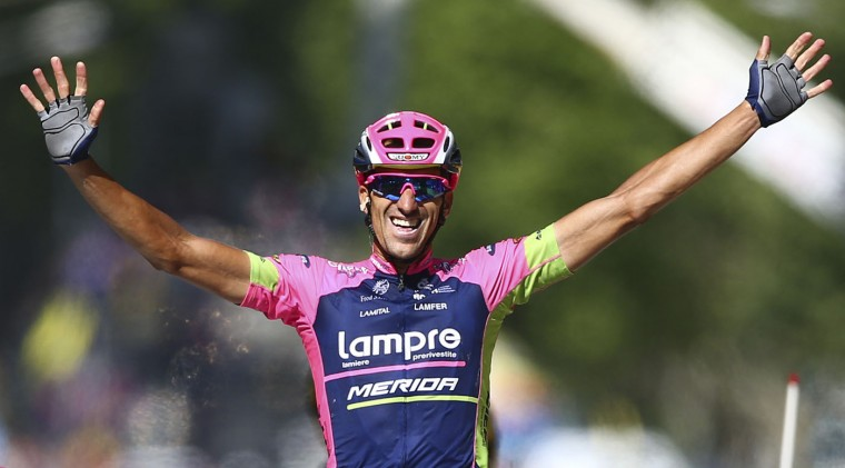 Spain's Ruben Plaza Molina celebrates as he crosses the finish line to win the sixteenth stage of the Tour de France cycling race over 201 kilometers (124.9 miles) with start in Bourg-de-Peage and finish in Gap, France, Monday, July 20, 2015. (AP Photo/Peter Dejong)