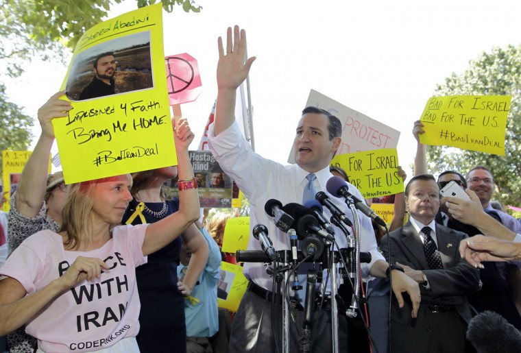Republican Presidential candidate, Sen. Ted Cruz, R-Texas, is interrupted by Code Pink anti-war group co-founder Medea Benjamin, left, during a demonstration by the Concerned Women for America Legislative Action Committee (CWALAC) to address the Obama administration's nuclear deal with Iran and the fact it leaves four Americans behind, Thursday, July 23, 2015, near the White House in Washington. (AP Photo/Luis M. Alvarez)