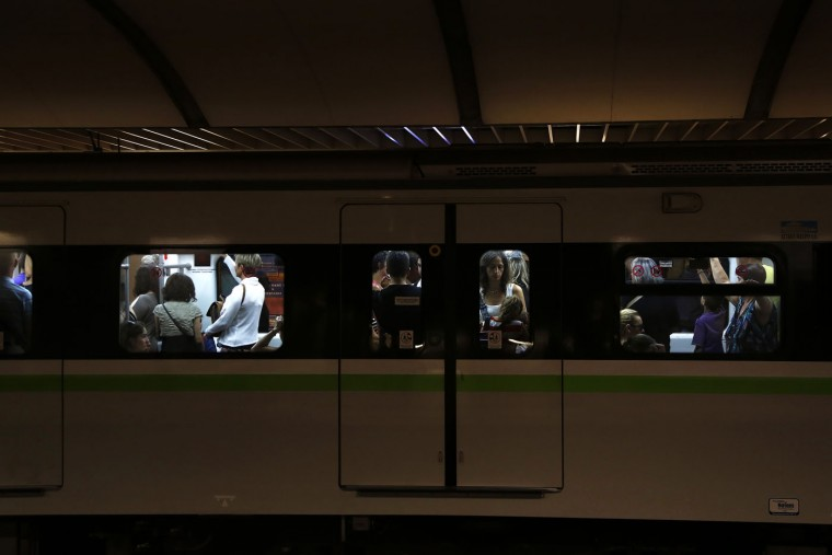 Passengers are seen in the train car at Omonoia Metro station in central Athens, on Thursday, July 2, 2015. Greece braced for more chaos on the streets outside its mostly shuttered banks Thursday, as Athens and its creditors halted talks on resolving the country's deepening financial crisis until a referendum this weekend. (AP Photo/Petros Karadjias)