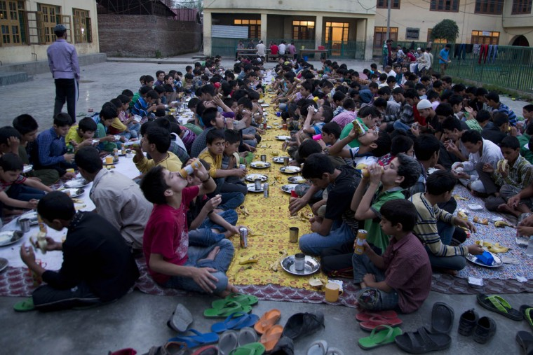 Kashmiri Muslim orphan children break their day long fast, at the Rahat Manzil Orphanage in Srinagar, Indian controlled Kashmir, Monday, July 6, 2015. Muslims across the world are observing the holy fasting month of Ramadan, where they refrain from eating, drinking and smoking from dawn to dusk. (AP Photo/Dar Yasin)