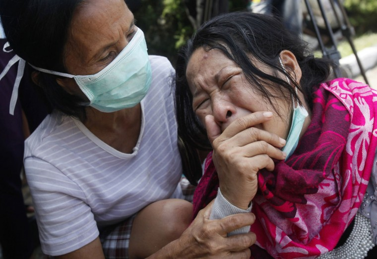 "Family members members of passengers on a military plane that crashed onto a residential area weep at a hospital in Medan, North Sumatra, Indonesia, Thursday, July 2, 2015. The aging Indonesian military transport plane that crashed into a residential neighborhood of Medan had a propeller ""abnormality"" that indicated an engine stalled, the air force chief said Thursday. (AP Photo/Binsar Bakkara)"