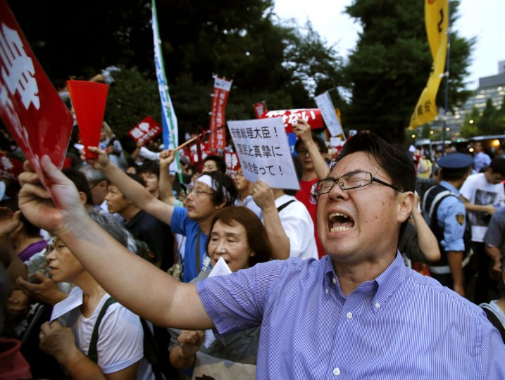 Anti-war protesters yell during a rally outside the Parliament building in Tokyo after Japan's lower house of parliament approved legislation that would expand the role of the nation's military Thursday, July 16, 2015. (AP Photo/Shuji Kajiyama)