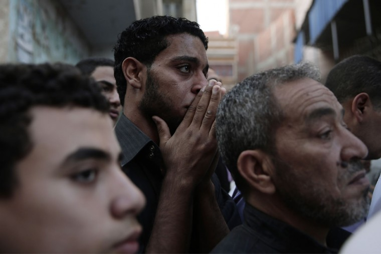 Egyptian mourn the funeral procession of 1st Lt. Mohammed Adel Abdel Azeem, killed in Wednesday's attack by Islamic militants in the Sinai, at his home village Tant Al Jazeera in Qalubiyah, north of Cairo, Egypt, Thursday, July 2, 2015. Islamic State-linked militants launched an unprecedented wave of attacks in northern Sinai on Wednesday, setting off the fiercest fighting the peninsula has seen in decades and undermining government efforts to stem the insurgency. (AP Photo/Hassan Ammar)