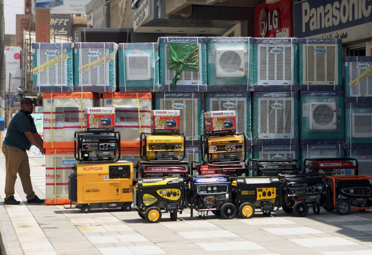 Air conditioners and power generators are displayed on a street in central Baghdad, Iraq, Thursday, July 30, 2015. Scorching temperatures are normal this time of year, but an unprecedented heat wave prompted Iraqi authorities to declare a mandatory four-day holiday beginning Thursday. For some Iraqis, heat waves mean big business. With rampant power cuts, some generators, which could sell anywhere from $200 to $800, are flying off the shelves. (AP Photo/ Khalid Mohammed)