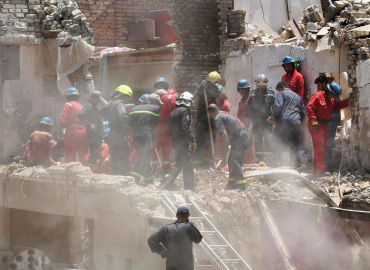 Iraqi security forces search for survivors after a bombing in the eastern neighborhood of New Baghdad. Iraq, Monday, July 6, 2015. At least a dozen civilians were killed on Monday when a Russian-made fighter jet accidentally dropped a bomb over a Baghdad neighborhood, officials said. (AP Photo/ Hadi Mizban)