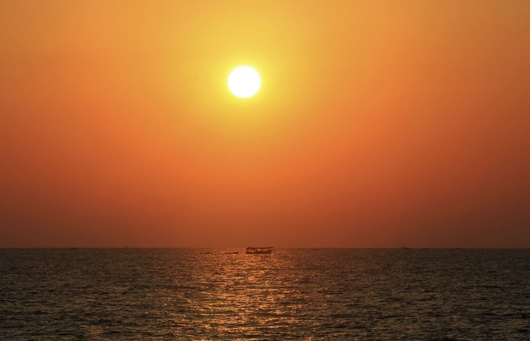 Palestinian fishermen sail into waters of the Mediterranean Sea at sunset in Gaza in the northern Gaza Strip on Thursday, July 30, 2015. (AP Photo/Adel Hana)