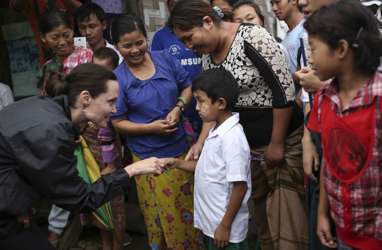 Actress Angelina Jolie Pitt, left, United Nations High Commissioner for Refugees special envoy and co-founder of the Preventing Sexual Violence Initiative, visits Jan Mai Kaung refugee camp in Myitkyina, Kachin State, Myanmar, Thursday, July 30, 2015. The refugees have fled fighting between the Burmese government and the Kachin Independence Army since 2011. (AP Photo/Hkun Lat)