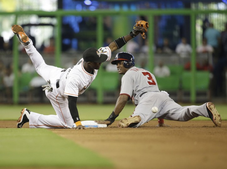 Washington Nationals' Michael Taylor (3) beats the throw to Miami Marlins shortstop Adeiny Hechavarria, left, to steal second in fifth inning of a baseball game, Thursday, July 30, 2015, in Miami. (AP Photo/Lynne Sladky)