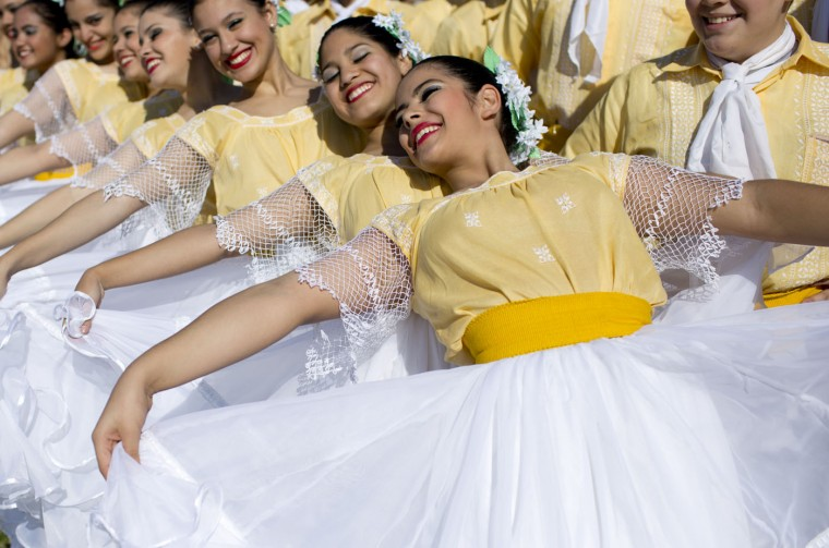 Dancers pose for a picture as they rehearse the performance they'll do during Pope Francis' visit to Asuncion, Paraguay, Thursday, July 9, 2015. The pontiff arrives to Paraguay on July 10, the last country he's visiting during his three-nation South American tour. (AP Photo/Natacha Pisarenko)