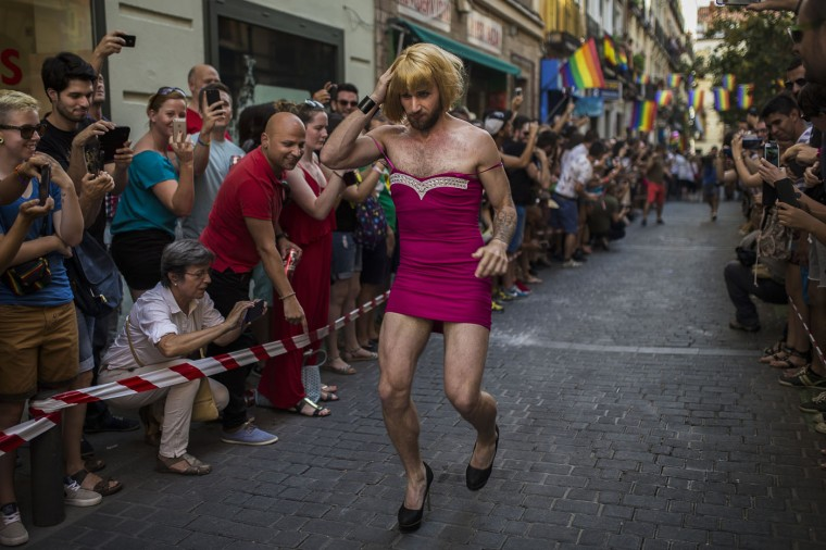 A competitor runs during the Gay Pride High Heels race in Madrid, Spain, Thursday, July 2, 2015. (AP Photo/Andres Kudacki)
