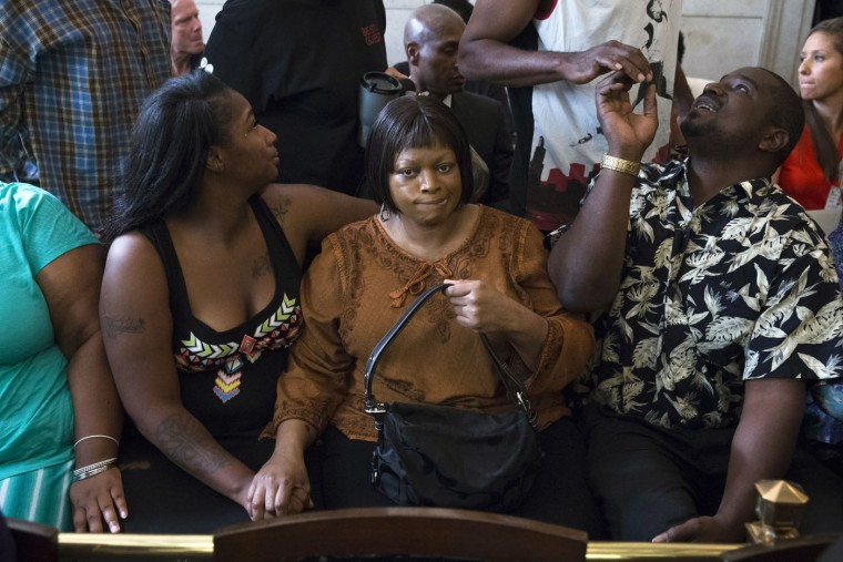 Terina Allen, sister of Samuel DuBose, sits with family members as she reacts in the courtroom following the arraignment of former University of Cincinnati police officer Ray Tensing at Hamilton County Courthouse for the shooting death of motorist DuBose, Thursday, July 30, 2015, in Cincinnati. Tensing, who was indicted and fired from his job on Wednesday, shot and killed Dubose on July 19. Tensing pleaded not guilty to charges of murder and involuntary manslaughter. (AP Photo/John Minchillo)