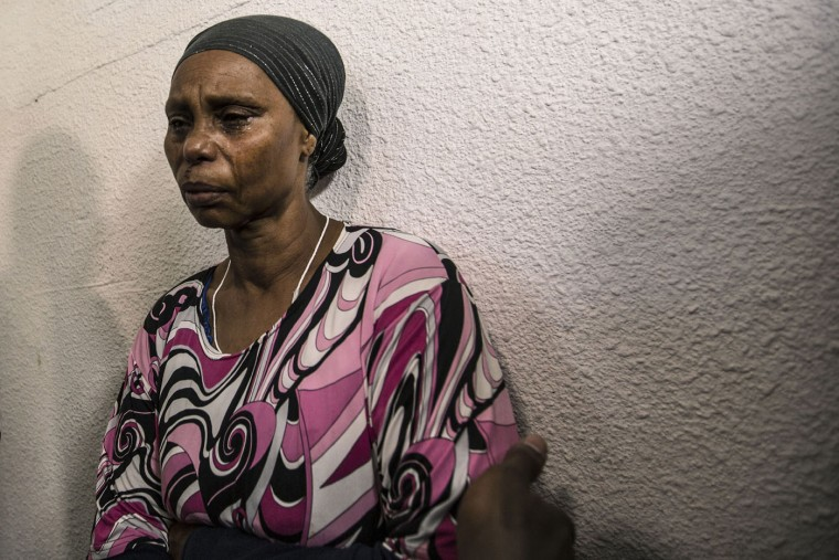 The mother of Ethiopian-Israeli Avraham Mengistu, cries after a family press conference in the costal city of Ashkelon, Israel, Thursday, July 9, 2015. An Israeli security official said Thursday the Hamas militant group has been holding Mengistu in the Gaza Strip for nearly a year. The Israeli defense body responsible for Palestinian civilian affairs, said Mengistu, born in 1986 from the Israeli city of Ashkelon, independently crossed the border fence into the Gaza Strip in September last year, nearly two weeks after the end of the Israel-Gaza war. (AP Photo/Tsafrir Abayov)